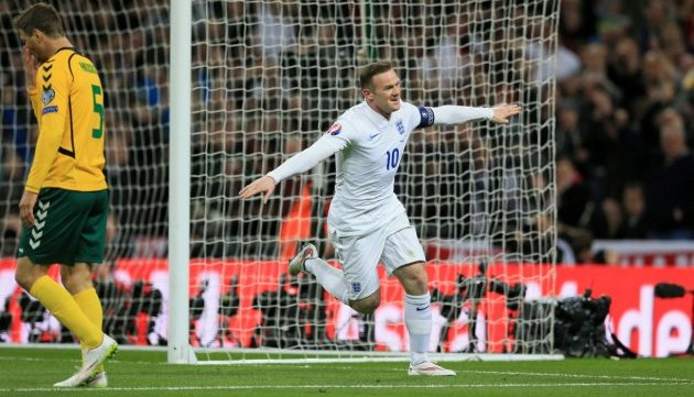 England's Wayne Rooney celebrates scoring his sides first goal of the game against Lithuania.